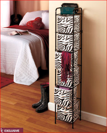 "Save precious space while keeping any room organized with a 6-Bin Storage Unit. This compact yet roomy unit has 6 removable nonwoven bins with convenient 4"" handles. Use them to hold everything from bathroom to bedroom accessories. Tall and slim, the metal frame has plastic-tipped feet that won't scratch your floor. It has a small rack on top for extra space or light decorative items. The Purple choice bins come in graduated shades of light and dark purple. Assembly required; assembly hardware included. 56-1/2"" x 10-1/4"" sq., overall. Bins, 8-1/2"" x 8"" sq., each. Imported."