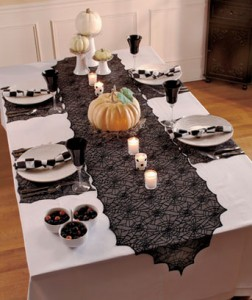 Dress your dining room for your Halloween celebration with this spooky 5-Pc. Spiderweb Lace Table Set.