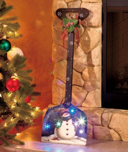 Decorative Lighted Snowman Shovel is a whimsical addition to your holiday setting.