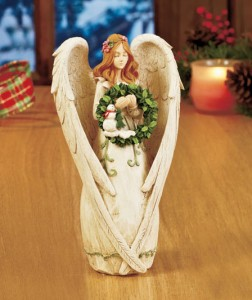 Seasonal Angel Figurine graces your decor with a lovely look for any time of year.
