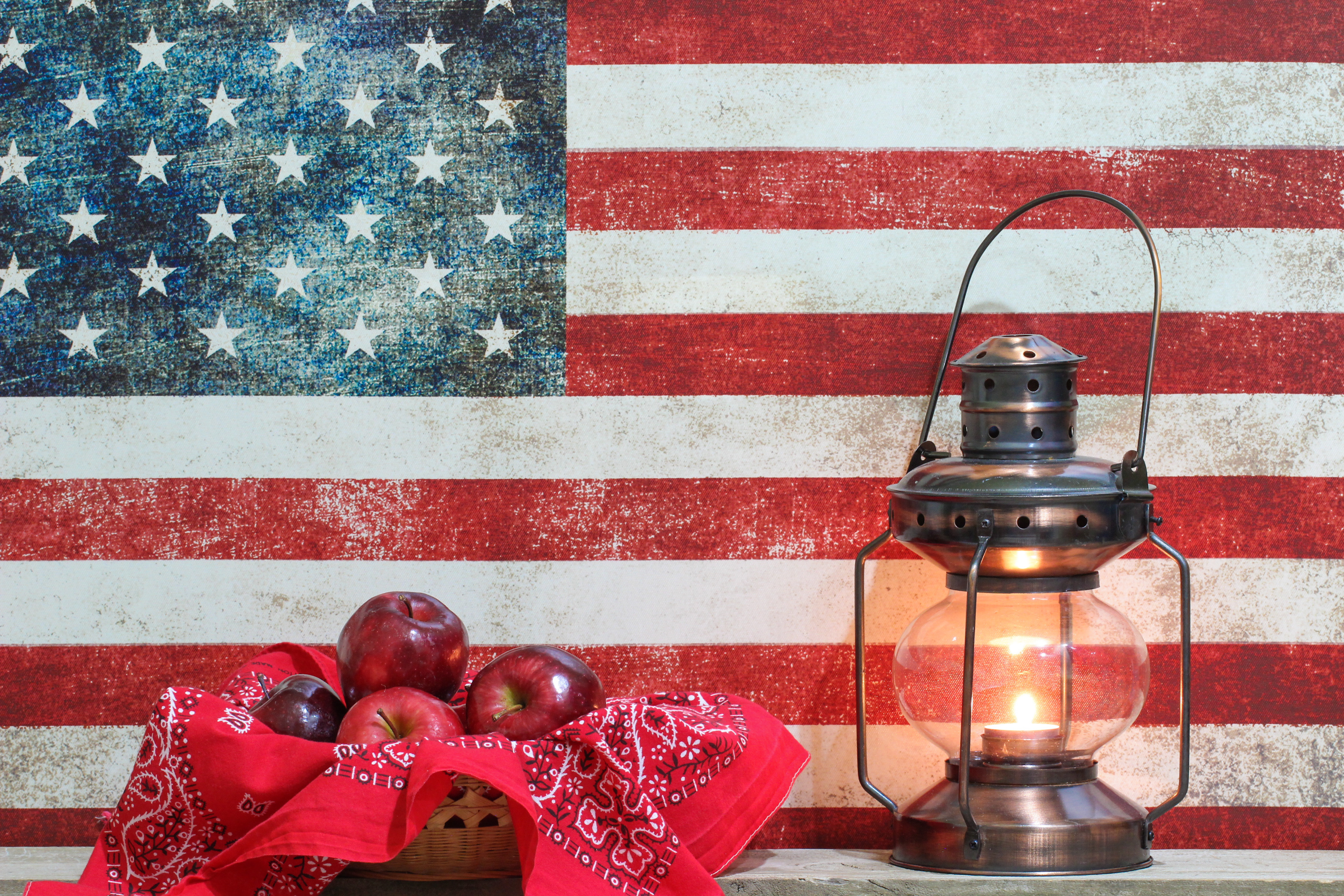 basket-of-apples-with-american-flag-background