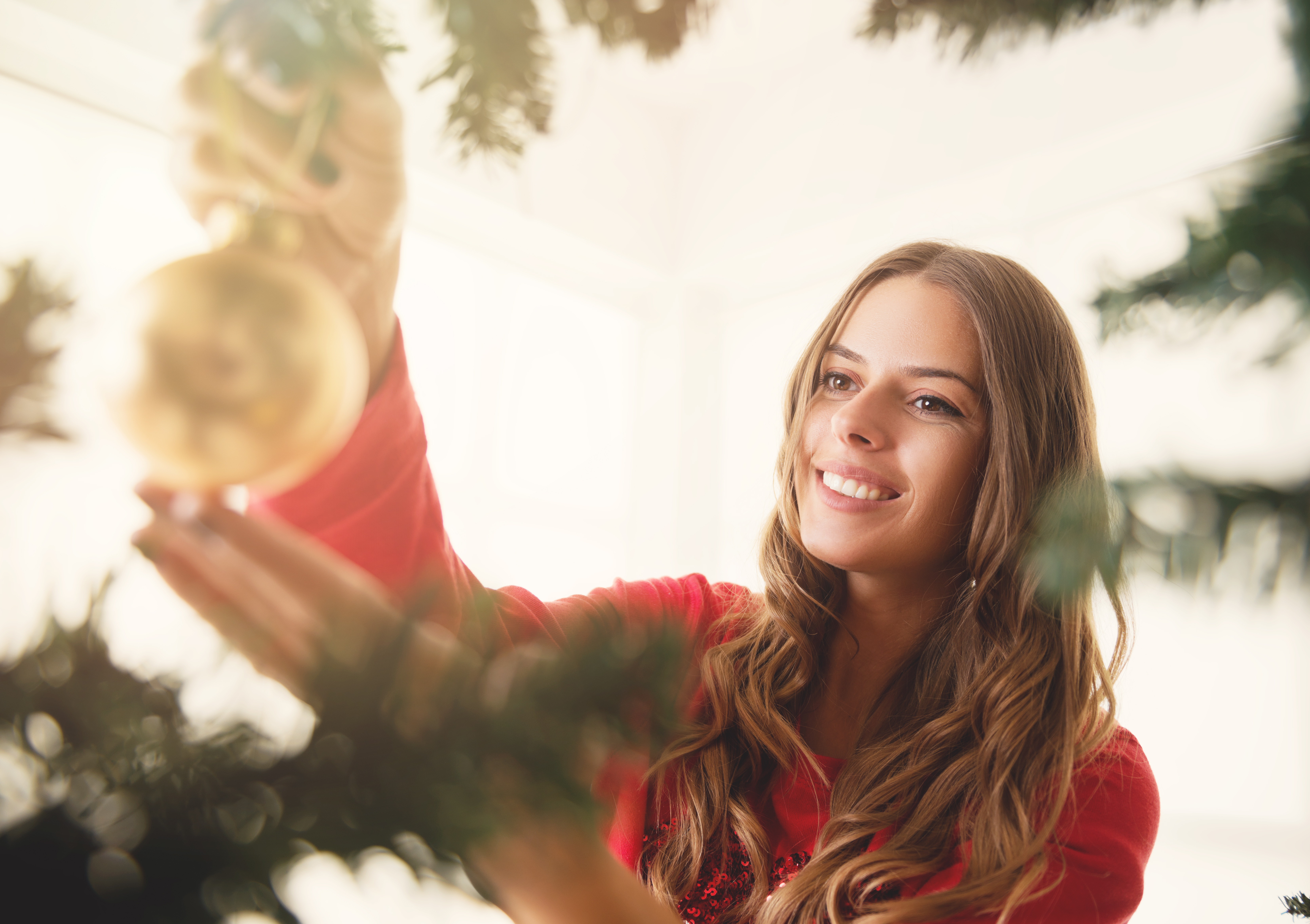 young-woman-decorating-Christmas-tree