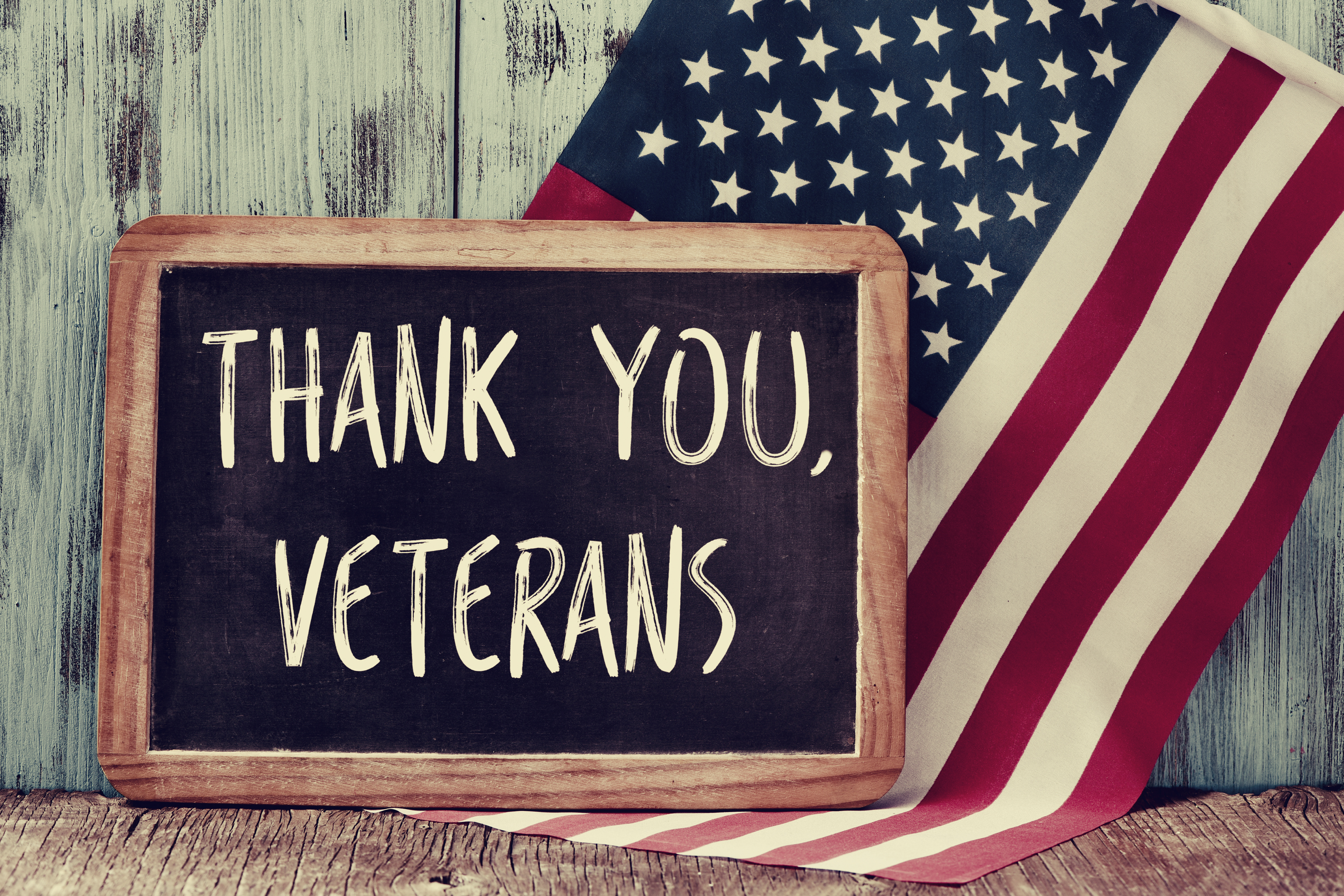 thank-you-veterans-chalkboard-with-american-flag-background