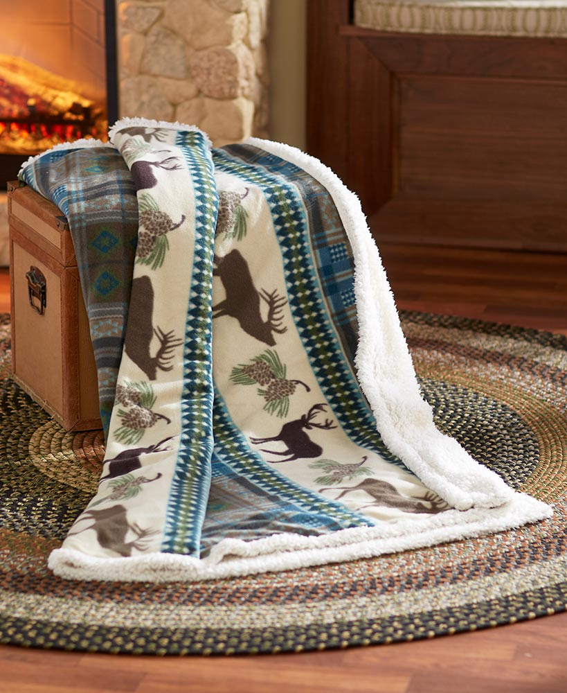 Plaid fleece and sherpa blanket with moose pattern