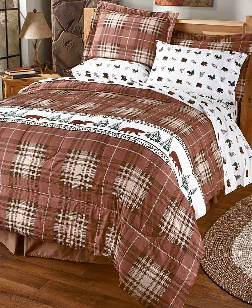 Brown plaid comforter with bear and tree pattern