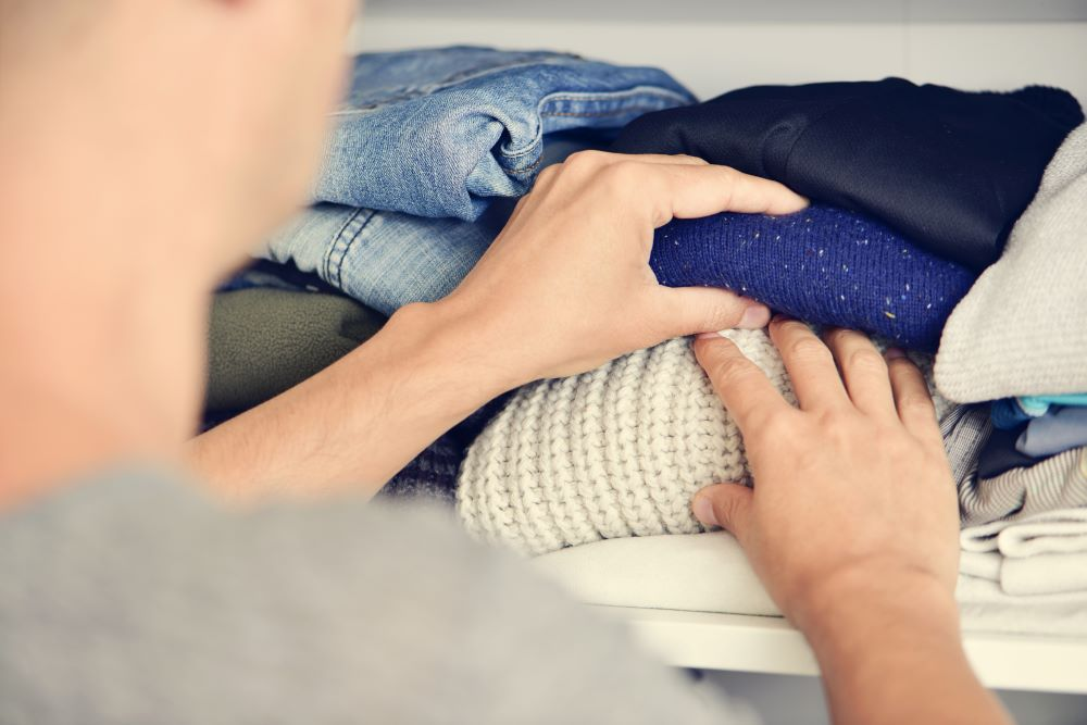 How To Organize Closet - Folded Sweaters