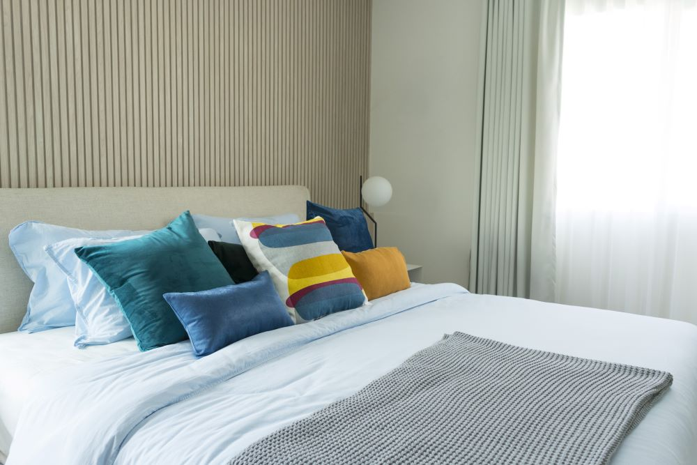 Bed With Colorful Throw Pillows