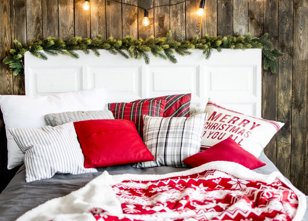 Bed With Christmas Throw Pillows And Blanket