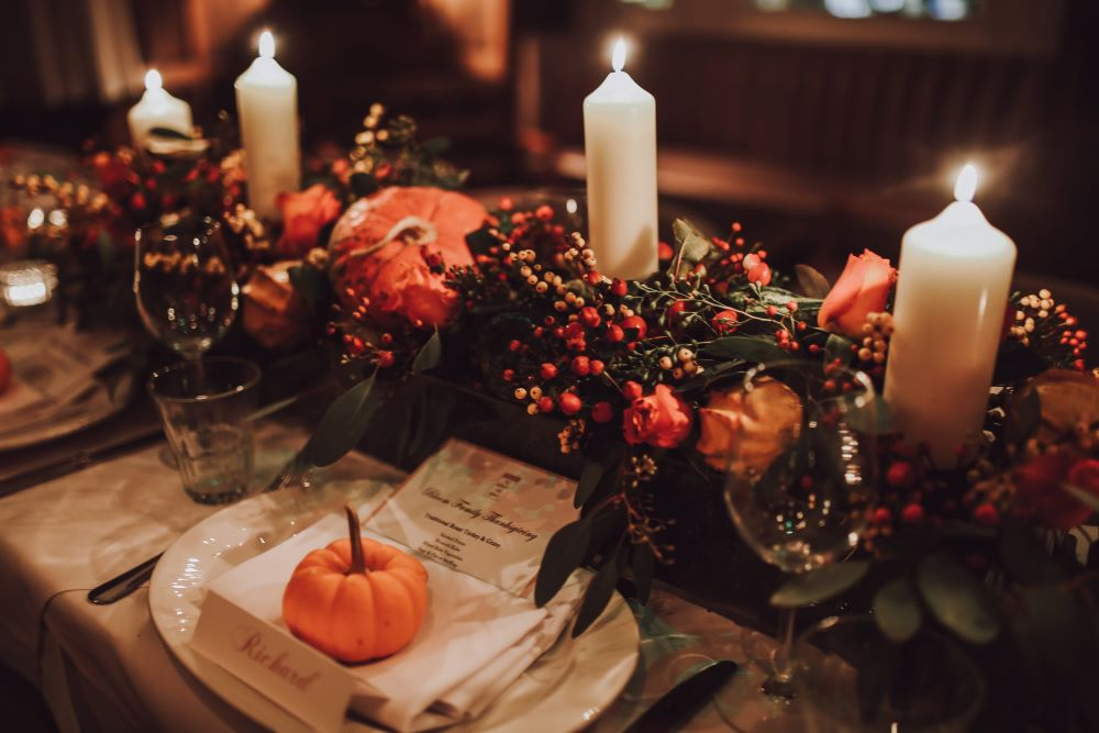 Thanksgiving table centerpiece with pumpkins and candles