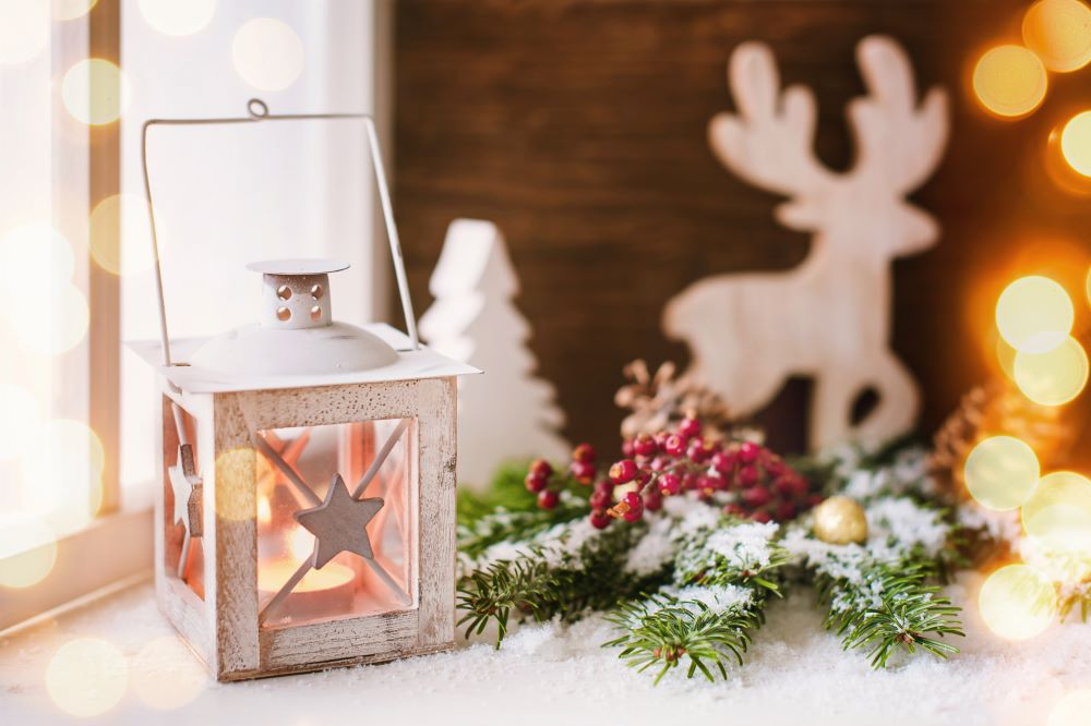 Christmas Decorating Ideas For Small Spaces - Window With Lantern & Christmas Greenery