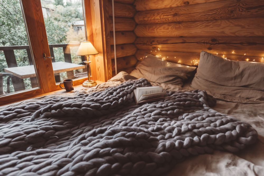 How To Keep Your Home Warm & Cozy - Add Extra Blankets To Your Bed