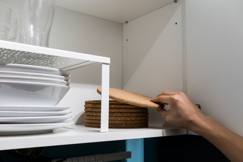 How To Organize Your Kitchen Cabinets - Use Shelf Risers
