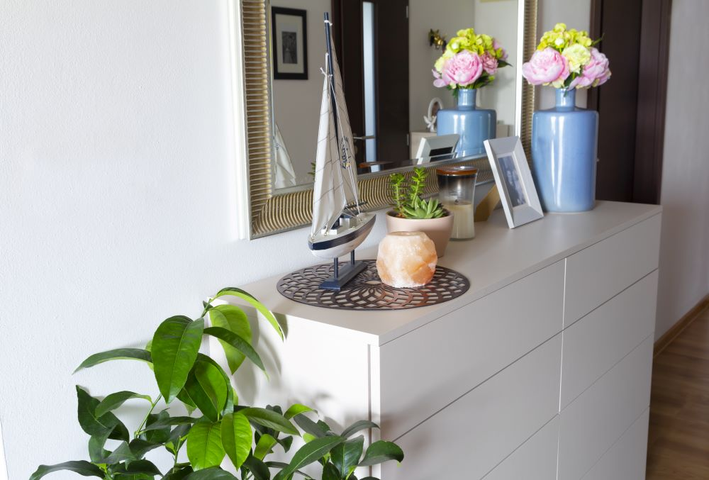Balance Out Your Dresser With Various Height Decorations
