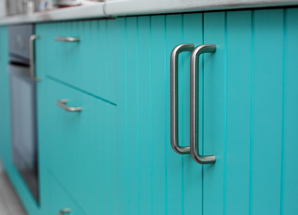 Affordable Kitchen Makeover Ideas - paint your kitchen cabinet and update hardware