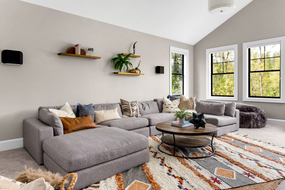 Style Your Living Room On A Budget - use a rug as a centerpiece