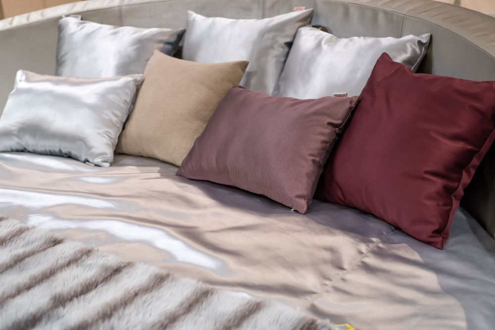Make Your Space Look Elegant For Less - add throw pillows to your bed and couch