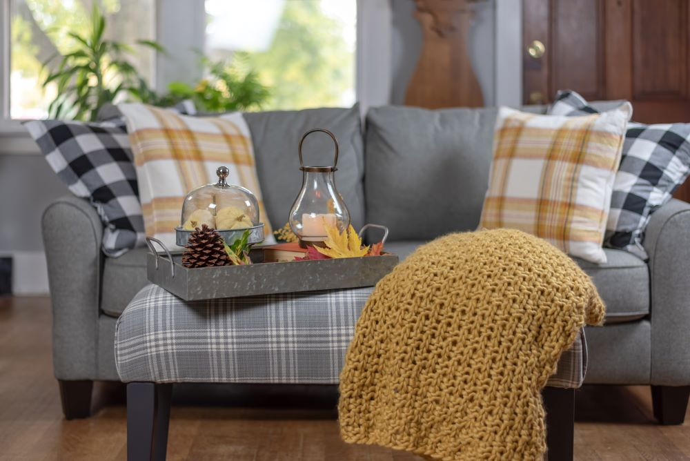 How To Transition Your Home From Summer To Fall - fall blankets and pillows