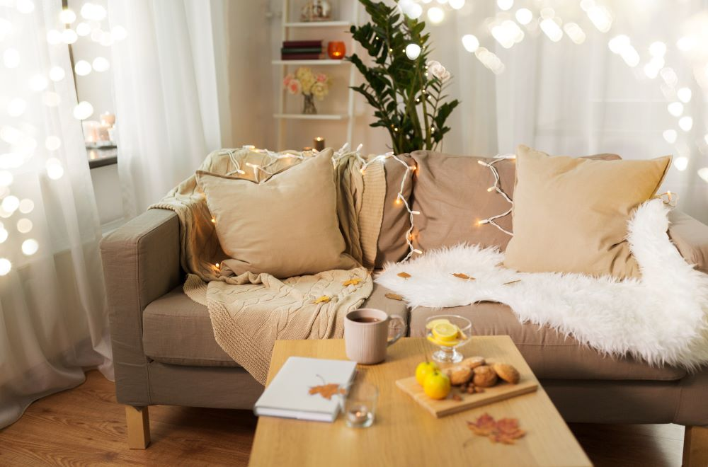 How To Make Your Home Cozy For Fall - layered pillows and blankets on couch
