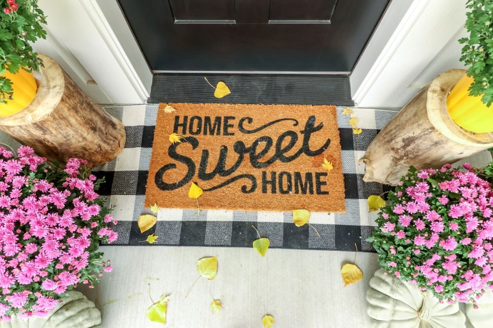How To Make Your Home Cozy For Fall - layered doormats for fall porch