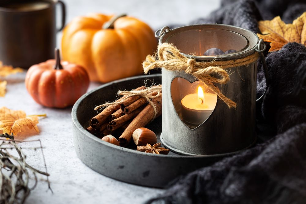 pumpkins and fall candle