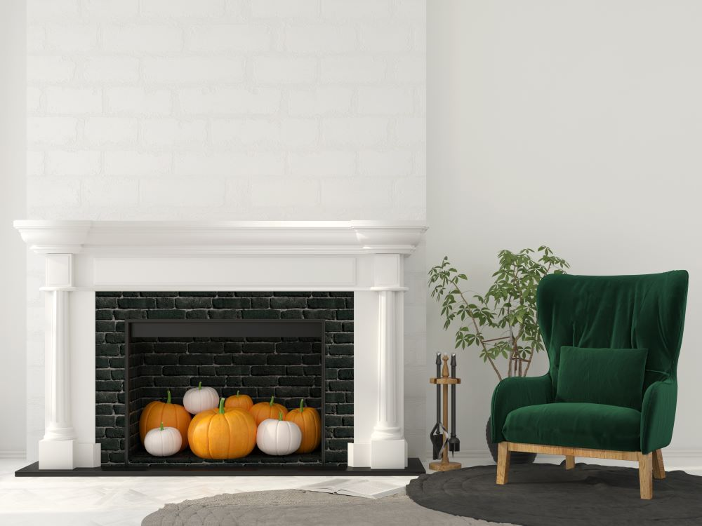 Ways To Decorate Your Home With Pumpkins - fireplace with pumpkins