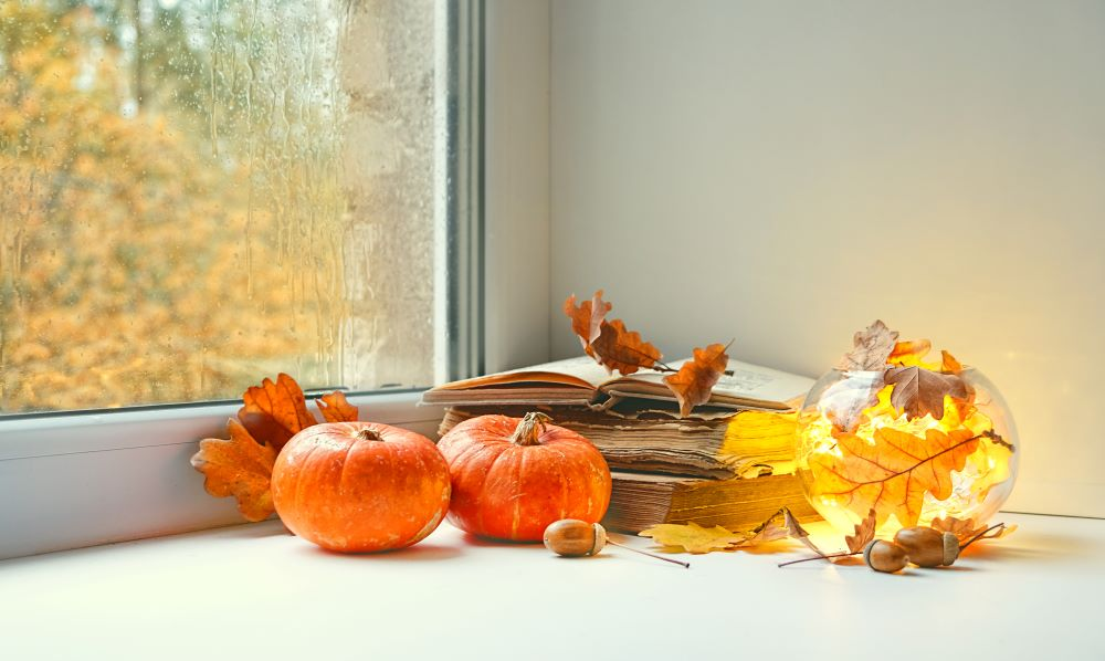 Ways To Decorate Your Home With Pumpkins - windowsill fall display